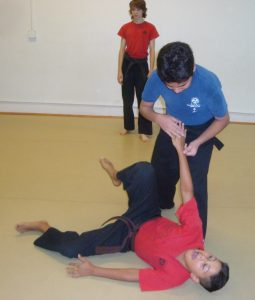 peers help each other through kids karate mistakes