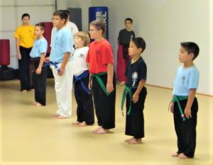 kids and adults develop a positive attitude through karate