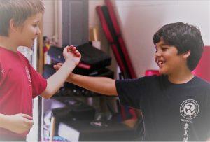 Partner work in kids' karate.
