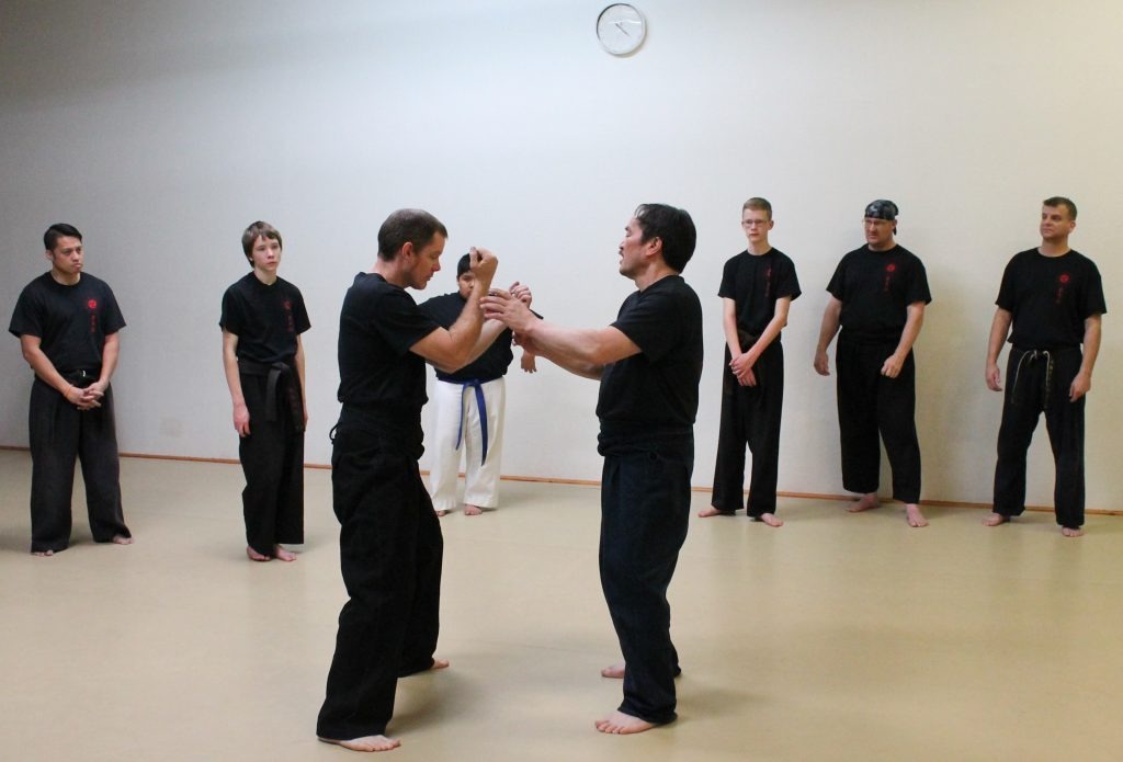instructor explains natural body motion and spatial awareness in karate class