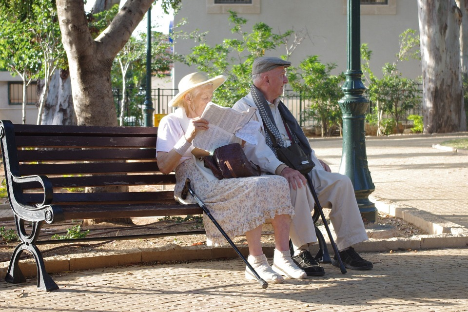 senior life couple on park bench
