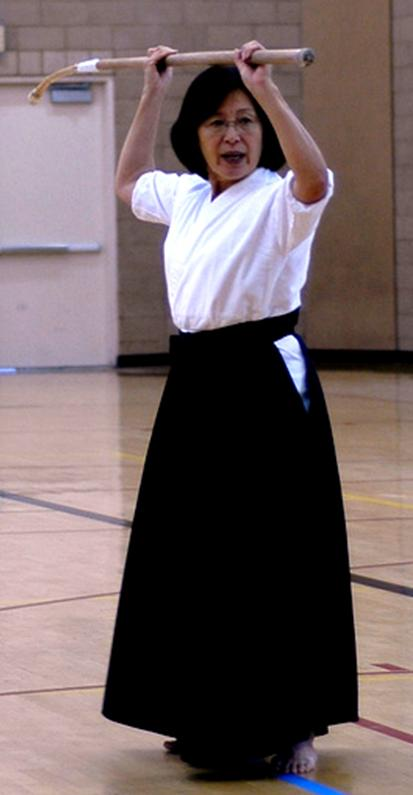 Woman training with naginata, much as the mother of the samurai kid did.
