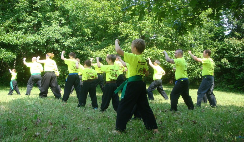 a group of martial artists training outdoors at U.R.K.A. Summer Camp