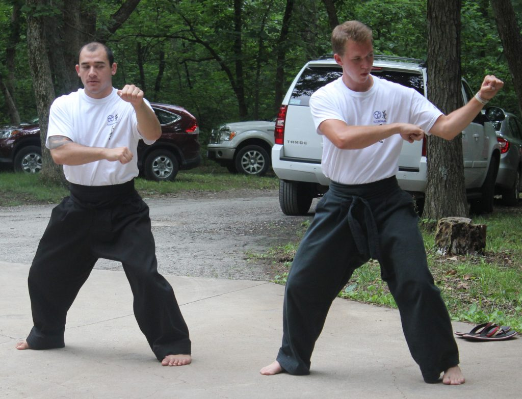 URKA practitioners using the core principles in their stances and body positions.