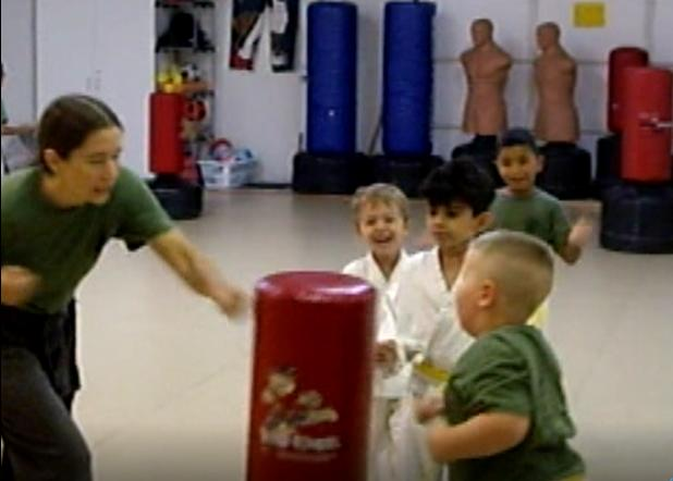 Little Dragons fun hitting the heavy bag in early childhood karate
