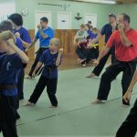 kids and adults practicing karate
