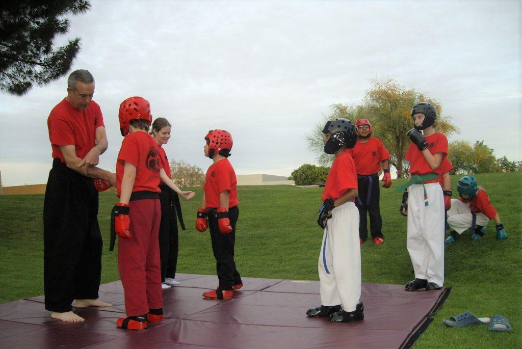 karate teacher giving a kid safety tips