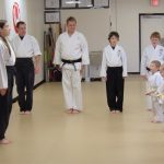 A Little Dragons' young kids' karate class lined up.