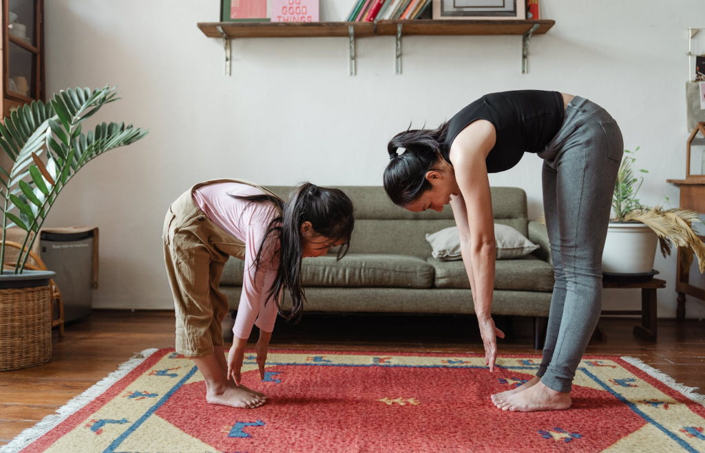 kid and mom stretch and exercise